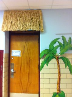 I made this Tiki-style awning for my daughter's school classroom door. ( We did her room in a beach theme. ). Thank goodness for industrial-strength tape!  After I took this pic she found a bamboo frame for the door sign