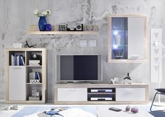 Moderná obývacia zostavaMnožstvo úložného priestoruMasívny vzhľad vďaka orámovaniu korpusuPredná plocha biela matná Vrátane LED osvetleni  https://mojinterier.sk/produkty/obyvacka/obyvacie-steny/obyvacia-stena-shark/