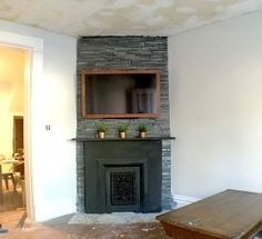 diy 40 wood tv frame works for tvs that tilt and rotate too, concrete masonry, fireplaces mantels, painting, roofing, woodworking projects