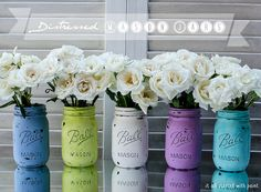 """mason jars painted and distressed - paint outside of jar with acrylic paint and let sit overnight. """"Distress"""" with a nail file and then spray with a clear coat or enamel."""