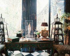 Living Room - A faux-malachite desk topped with a stuffed cockatoo -Dawnridge
