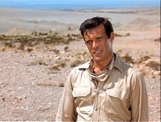 """Chris in a scene from """"The Rat Patrol"""". The Rat Patrol, Christopher George, Rats, Behind The Scenes, Tv Shows, Raincoat, Actors, Couple Photos, Troy"""