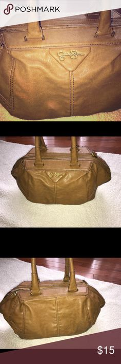 Jessica Simpson Purse Jessica Simpson is in good condition! Purse comes with a strap that allows you to wear it as a crossbody purse. Purse has one strap loop that has come apart from the purse (see pics). Purse size: Medium Jessica Simpson Bags Crossbody Bags