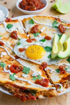 I\'ve been a little obsessed with quesadillas lately and my most recent whim was to try huevos rancheros , a Mexican style breakfast with tortillas, eggs, refried beans and salsa ranchera, . Huevos Rancheros, Quesadillas, Mexican Dishes, Mexican Food Recipes, Breakfast Time, Breakfast Recipes, Breakfast Ideas, Salsa Ranchera, Taco Bell