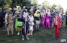Fans dressed in costume watch the morning foursomes matches at the Presidents Cup on September 30, 2017 at Liberty National Golf Club in…