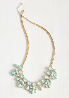 Glimmer is Coming Necklace. Faux gems and sweet beads delight this golden, curb-chain style in turquoise tones, marking the dawn of a sparkly season ahead. | shopswell