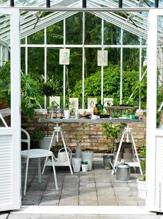 **Back of greenhouse** brick half wall with window wall above.