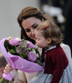 Princess Charlotte stops to smell the flowers before she and the rest of the royal family depart from Victoria and wrap up their tour of Canada's west coast. Photo: REX/Shutterstock