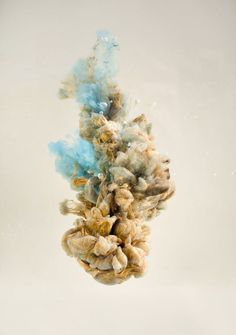 Double exposure images blend figures and faces with plumes of ink in water