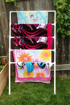 DIY PVC towel rack... and this one can fit in the garage for winter!