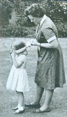 1964 - Diana, age 3, playing hide & seek with nanny.