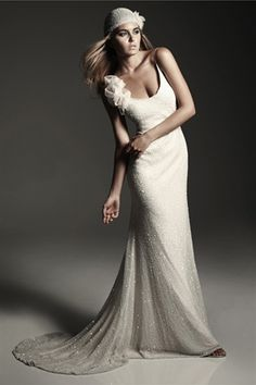 Full beaded gown, but understated.  Perfect for a night time beach wedding.  Think of the light it would catch!