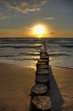 Sunset over the Baltic, Northern Germany. Oh my, what it would be like to walk across those log steps