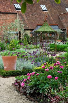 The Walled Garden at Cowdray    Beautifully-restored walled Tudor garden in West Sussex via Clive Nichols Garden Photography.