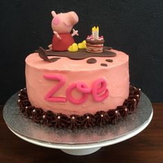 Peppa Pig cake 8 inch chocolate cake - with Swiss meringue buttercream - $100 Fondant Peppa Pig cake topper - $25 Total -$125