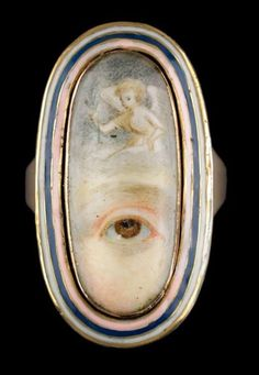 Georgian Eye Jewellery . A gold oval ring with a white, blue, and pink enamel eye portrait with angel, unknown artist and jeweller, ca. 1790 - 1820.  Victoria and Albert Museum , London
