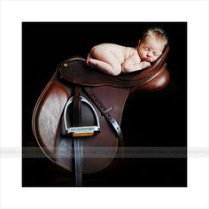 Baby and saddle... I want a picture like this when I have kids