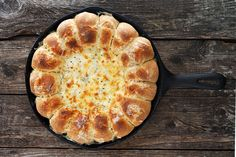 This Warm Skillet Bread and Artichoke Dip is a perfect appetizer or party food. Make rolls from scratch or use frozen dough.