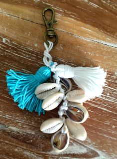 BOHO Keychain with Cotton Tassels and Cowrie Shells by ljcdesignss