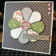 card with a flower quilt element on a dotted paper background...