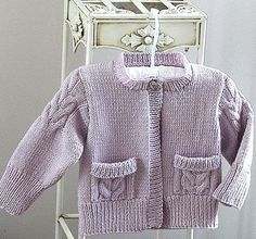 Knitting pattern for cute child's cardigan sweater featuring cable detail on the sleeves and pockets. 0-6 months, 6-12 months, 1-2 years, 2-3 years, 4-5 years, 6-7 years