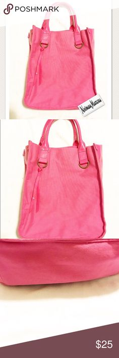 Neiman Marcus hot pink canvas and vinyl tote Neiman Marcus hot pink canvas and vinyl tote pre-owned but in very good condition.  Canvas front, back and bottom with vinyl sides to add texture to a monochrome look. Neiman Marcus Bags Totes