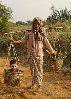 Boy in a basket, Burma.