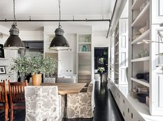 Large black pendants above the dining area play with scale and add an industrial vibe in Meg Ryan's home.