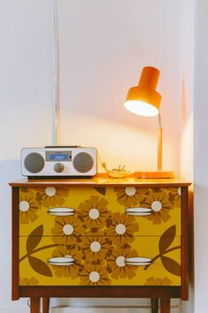 Cute chest of drawers re-invented with a 60's style print.
