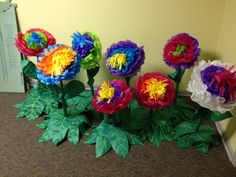 Check out this blog post for instructions on these bright and colorful rain forest flowers with stems and leaves for Journey Off The Map VBS 2015 .