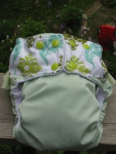 Cloth diaper I sewed from PUL and Joel Dewberry Aviary 2 damask in dill  lined with dimple velour in white with a little ruffle on the back in celery  #sew # diaper # cloth #homemade #baby #make