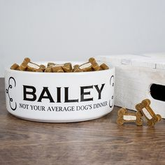 Deep ceramic dog bowl with the words 'Not Your Average Dog's Dinner' as standard. Can be personalised with your dog's name. Dimensions: 190mm x 70mm