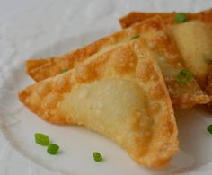 Baked Crab Rangoon...bake 425 for 12-15 minutes. 16 Ounces Cream Cheese, 1 Can (6 ounce) Crab Meat (drained and flaked), 4 -5 Green Onions, 1 Garlic Clove (about 1T) minced, 2 teaspoons Worcestershire Sauce, 1 teaspoon Soy Sauce, 1 package (48 count) Wonton Skins, 1/4-1/2 cup Butter (melted)