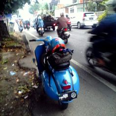 my vespa waiting the traffic..