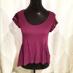 Plum Babydoll Top This high-low top has a soft front with sheer back & lace cap sleeves. Brand is TELA purchased from Urban Outfitters. Lightly worn, good condition. Made of rayon, spandex, polyester, & nylon. Urban Outfitters Tops Blouses