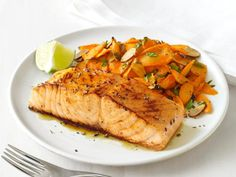 Glazed Salmon with Spiced Carrots : The combination of a sweet honey glaze and high-heat cooking creates a golden, crunchy layer of flavor on the salmon, while coriander and cumin add warm spice to sweet carrots. via Food Network Carrot Recipes, Salmon Recipes, Fish Recipes, Seafood Recipes, Dinner Recipes, Healthy Recipes, Healthy Dinners, Quick Recipes, Salmon Food