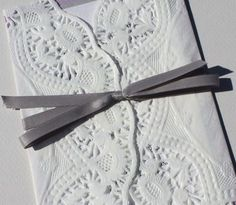Lace wedding invitation - fold a paper doiley around the stack of information, tie with twine?