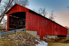 The red Oakalla Covered Bridge is a wooden, single span burr arch structure built in 1898 near Greencastle, Indiana