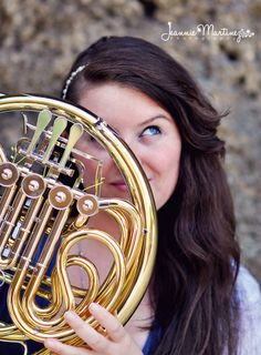 Senior picture with french horn.  Not this gaze for the boys.  Maybe him looking through the french horn?