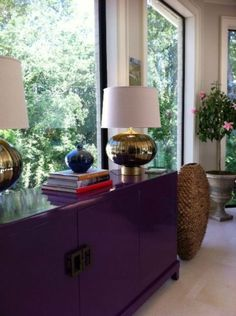 Glossy purple paint for TV cabinet.