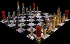 How about a game of Cartridge Chess, with chess pieces sourced from your own ammunition collection? We think the concept of a Cartridge Chess Set is pretty clever, and it's bound to be a conversation-starter at home or at the hunting lodge. Nostradamus Prophezeiungen, Play Chess Online, Bullet Crafts, Bullet Casing, Family Board Games, Damier, Chess Pieces, Firearms, Games To Play