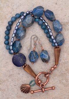 Lapis Coral and Pearl Triple Strand Blue Bracelet from sundancegems on Ruby Lane