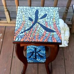 Kanji fire and water mosaic table.