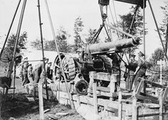 MINISTRY INFORMATION FIRST WORLD WAR OFFICIAL COLLECTION (Q 2909) Battle of Polygon Wood 26 September - 3 October: A new barrel is lowered into position on an 8 inch howitzer by the Army Ordnance Corps.