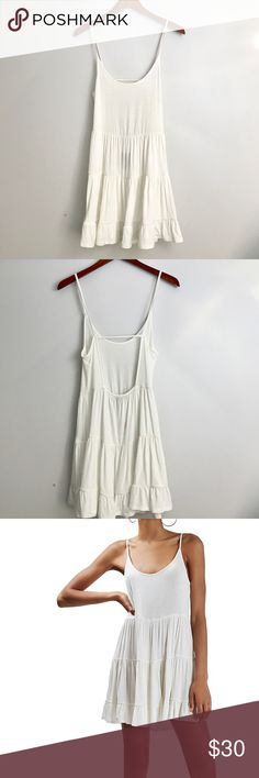 """Topshop Tiered Open Back Sundress Topshop Tiered Open Back Sundress, Size 4 US (fits like 0-2) - Ivory Soak up all those warm sunny rays in a lightweight jersey slipdress with a playfully ruffled tiered skirt. A dipped open back tethered by slender straps ensures all eyes are on you. 29"""" length. Slips on over head. Scooped neck. Adjustable straps. 93% viscose, 7% elastane. Machine wash warm, line dry. By Topshop; imported.  (NR2186) Topshop Dresses Mini"""