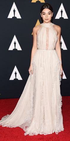 Hailee Steinfeld had a jaw-dropping moment on the red carpet when she arrived at the 8th Annual Governors Awards in her most angelic, most glam look to date: an ethereal open-back cream lace chiffon Elie Saab Haute Couture creation.