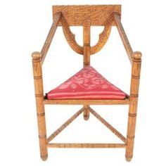"""The national chair of Sweden, the munkstol evokes the romance and craftsmanship of the Old World. Handmade from oak, this vintage design features elaborate chip carvings and an embroidered wool seat.  Product: MunkstolConstruction Material: Oak and woolColor: Brown and redDimensions: 34"""" H x 23"""" W x 19.5"""" D"""