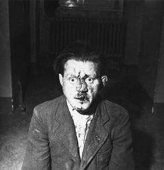 A Buchenwald concentration camp guard who tried but couldn't avoid a confrontation with his ex charges. He was arrested by US troops and thus avoided certain death. April 1945.  Elizabeth Miller.