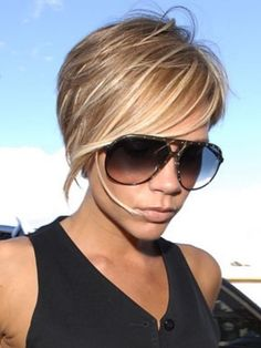Victoria Beckham's asymmetrical hair. growing out the shaved side cut