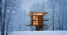 Designed by Oska Architects, Delta Shelter is a 1,000 sq. ft weekend cabin in Mazama, WA. It has a small 20' x 20' square footprint, which rises three stories high and is topped by the living room/kitchen.